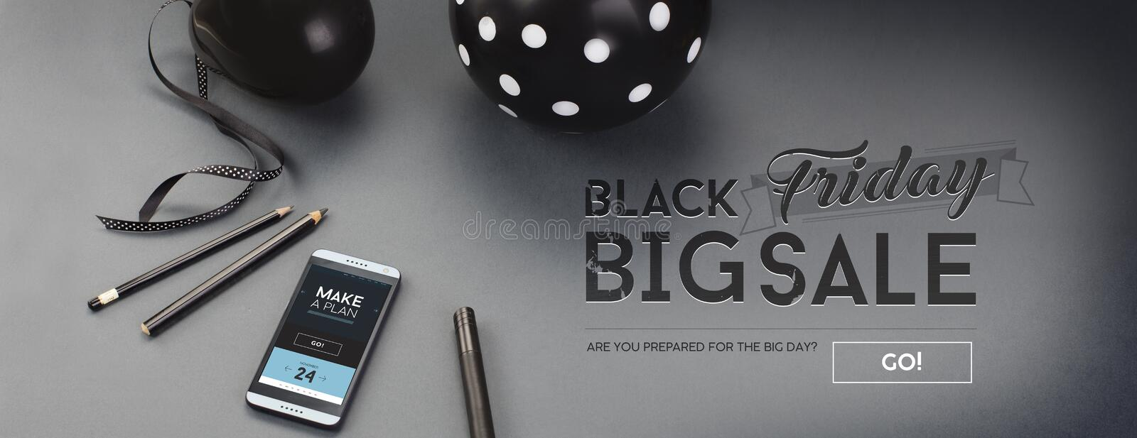 Black Friday sale banner, with black letters, balloon, pencils, ribbon and android cell-phone. royalty free stock photos