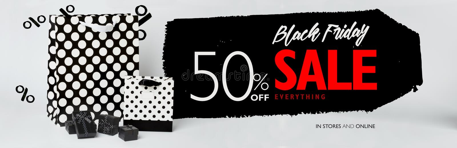 Black Friday sale banner, with small black gift-boxes, and black and white gift-bags with polka dots. stock photo
