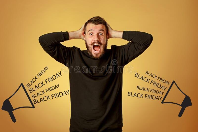 Black Friday sale - holiday shopping concept. Crazy businessman on orange background. . Black Friday sale - holiday shopping concept stock photo