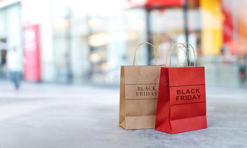 Black Friday sale shopping bags on floor front of mall. Black Friday sale shopping bags on floor front the mall store background, business, retail, banner and stock images