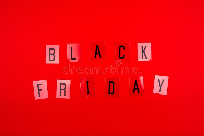 Black Friday sale tag on red background. stock photography