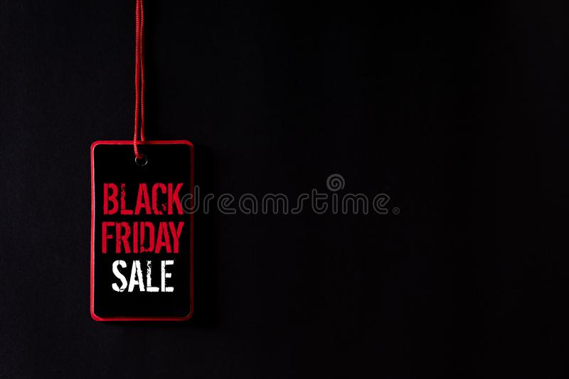 Black Friday Sale text on a red and black tag. Shopping concept.  stock photography