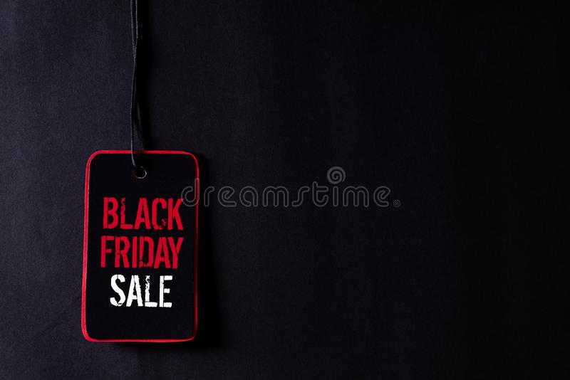 Black Friday Sale text on a red and black tag. Shopping concept.  stock photos
