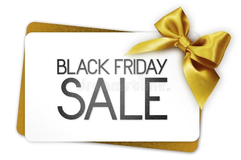 Black Friday sale text write on white gift card with golden ribbon bow stock photography