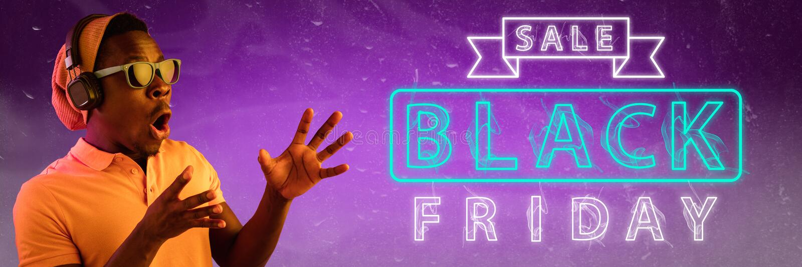 Black friday, sales. Modern design. Contemporary art collage. Black friday, sales, purchases concept. Neon lighted letters on gradient background. Astonished stock image
