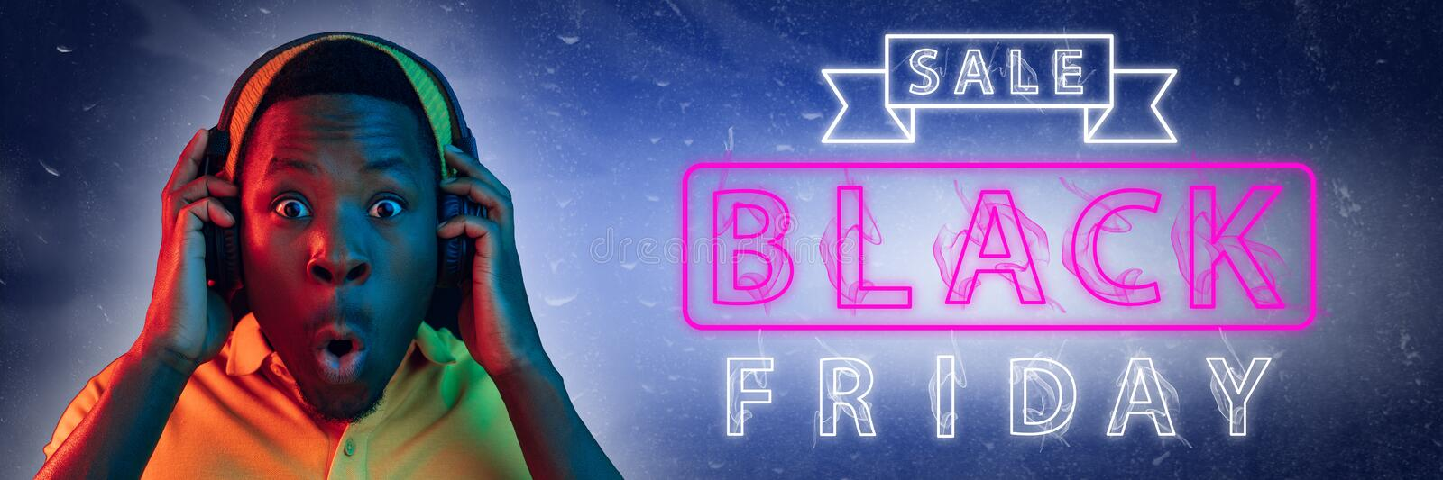 Black friday, sales. Modern design. Contemporary art collage. Black friday, sales, purchases concept. Neon lighted letters on gradient background. Astonished royalty free stock photos