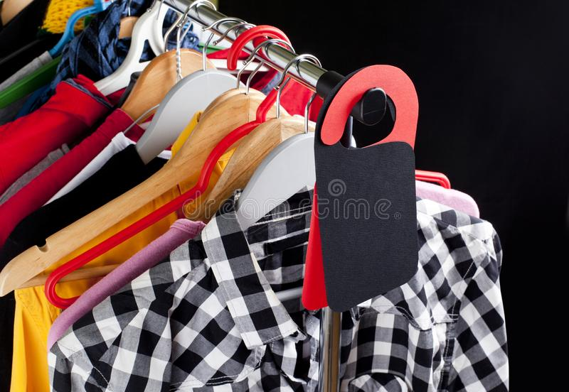 Black Friday shopping sale concept. Sale in a clothing store - discount sign at a clothes rack royalty free stock images