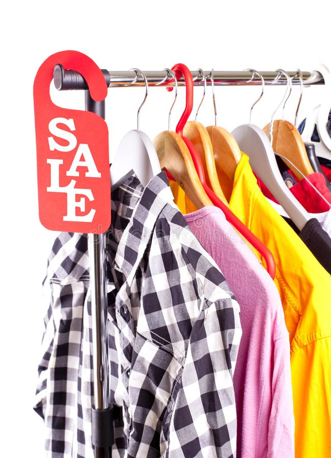 Black Friday shopping sale concept. Sale in a clothing store - discount sign at a clothes rack royalty free stock image