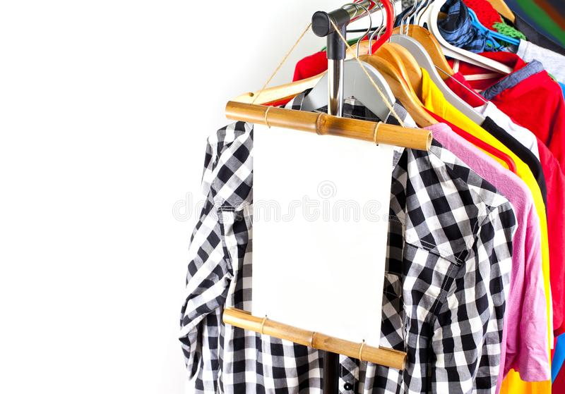 Black Friday shopping sale concept. Sale in a clothing store - discount sign at a clothes rack stock photography
