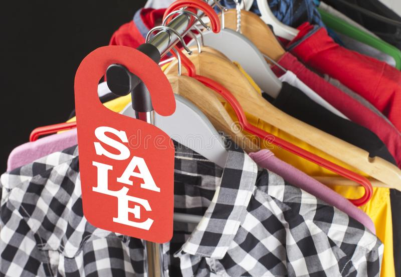 Black Friday shopping sale concept. Sale in a clothing store - discount sign at a clothes rack royalty free stock photos