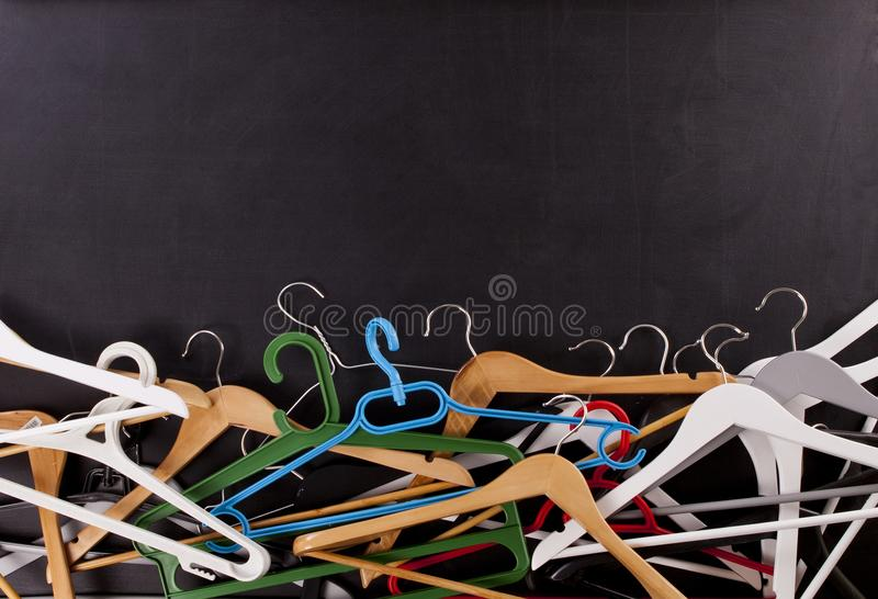 Black Friday shopping sale concept. Clothes hangers with copy space on black background stock photos