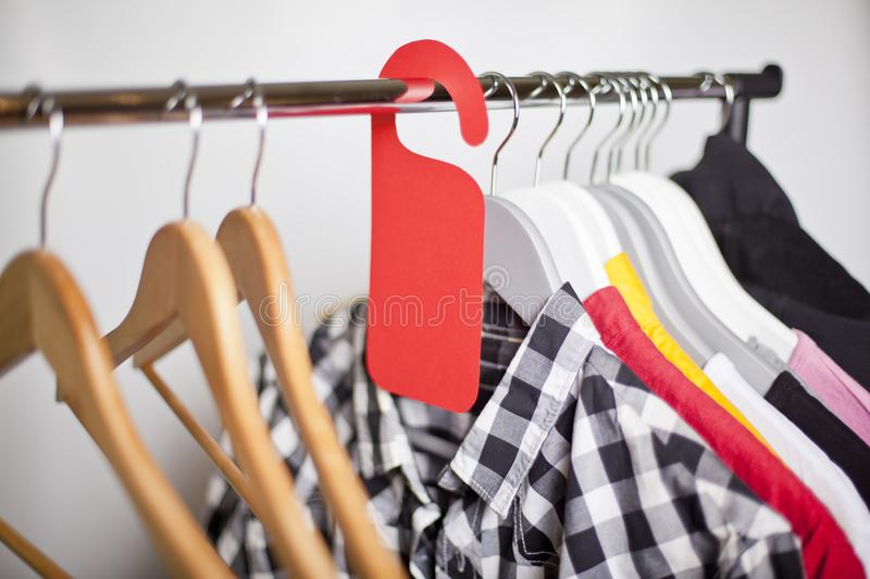 Black Friday shopping sale concept. Sale in a clothing store - discount sign at a clothes rack stock photo