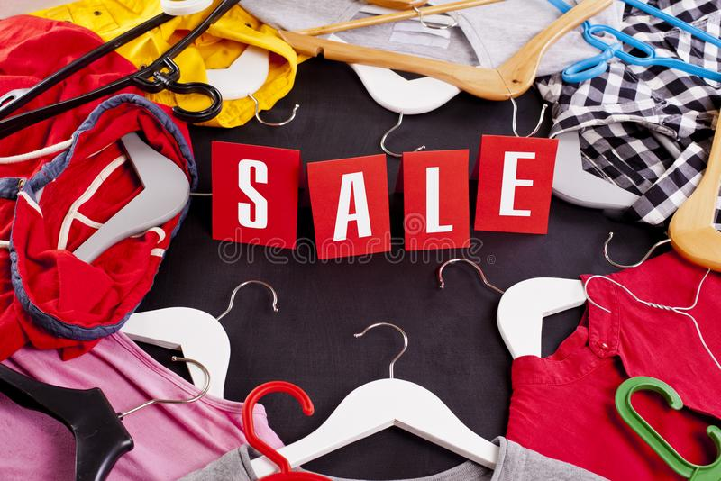 Black Friday shopping sale concept with red Sale tag and clothes.  stock photo