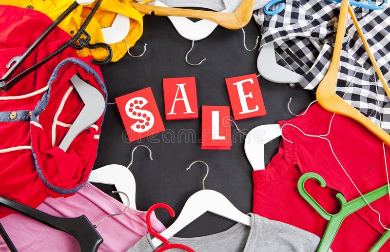 Black Friday shopping sale concept with red Sale tag and clothes.  royalty free stock photo