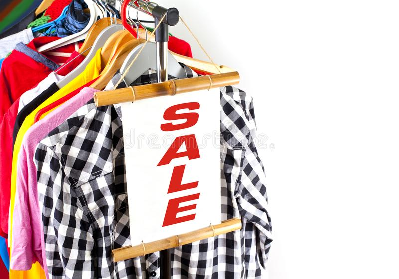 Black Friday shopping sale concept. Sale in a clothing store - discount sign at a clothes rack stock image