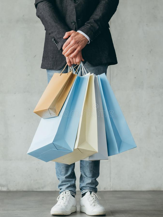 Black friday shopping sale discount bags man hold stock photos