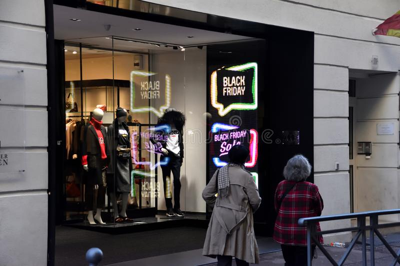 `black friday` sign in France. Marseille, France - November 24, 2018 : Two women walk past shop with `black friday` sign royalty free stock photos