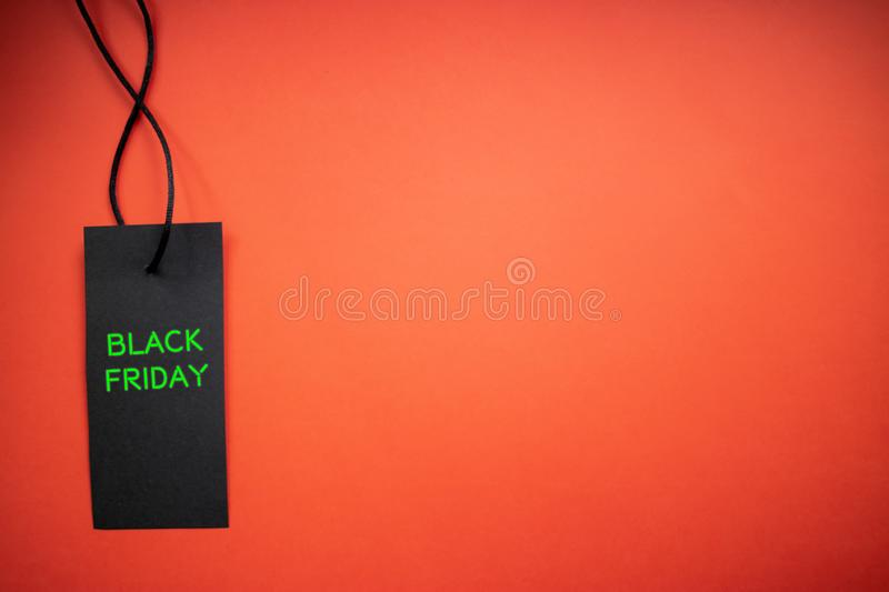 Black Friday tag on red background. Sale concept. Copy space.  royalty free stock photo