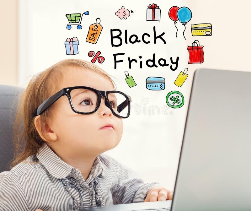 Black Friday-tekst met peutermeisje stock fotografie