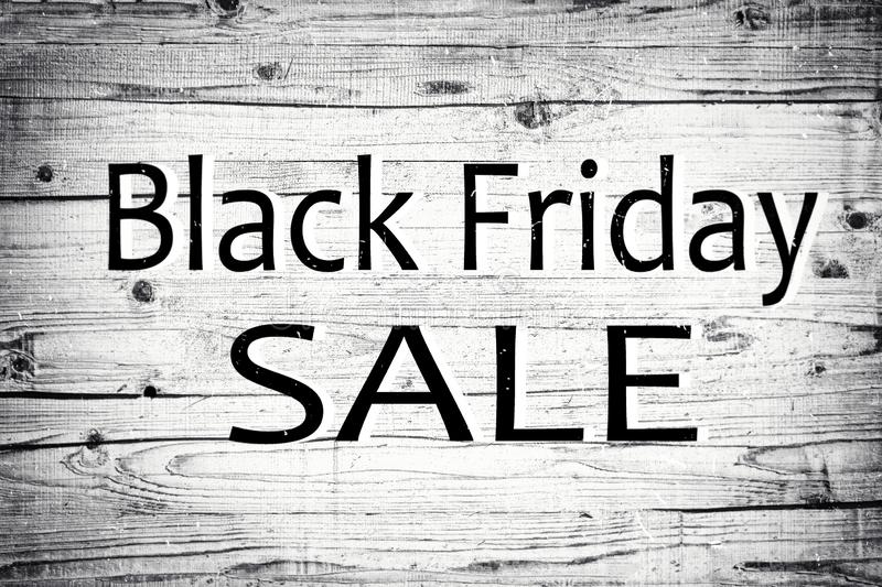 Black friday. The text black friday on wood texture background. Vintage antique grey boards. Concept: black Friday sale. Discounts stock photo