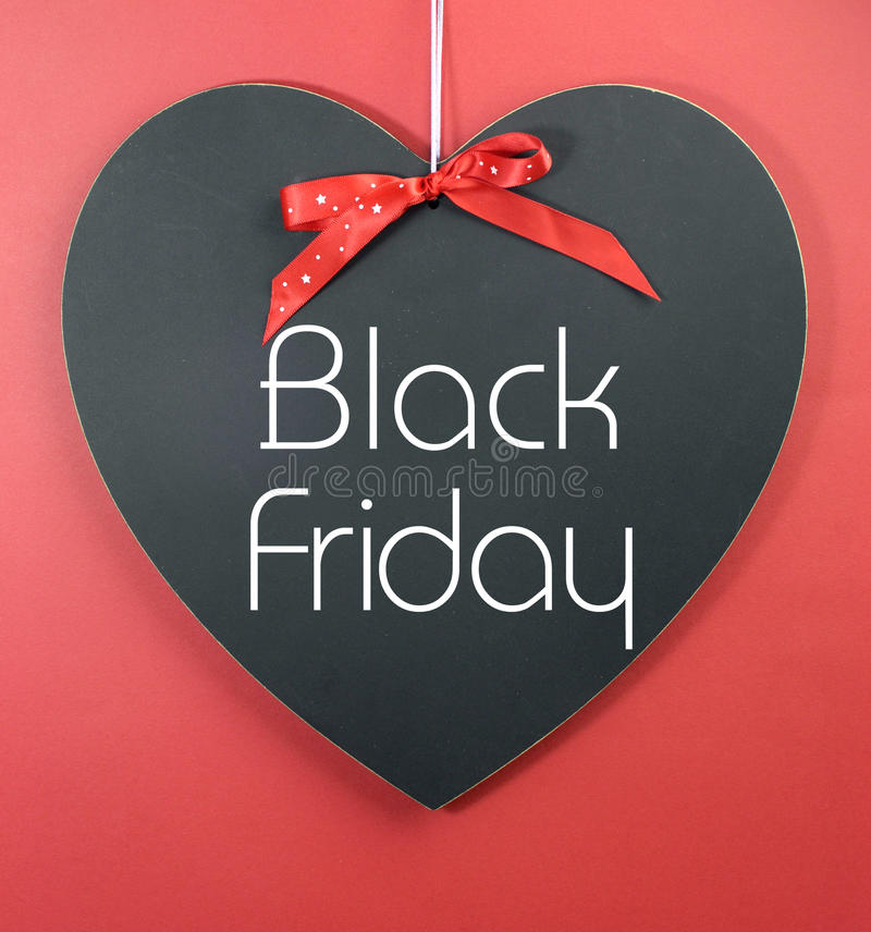 Black Friday zakupy sprzedaży pojęcie z wiadomością na kierowym kształta blackboard obrazy royalty free
