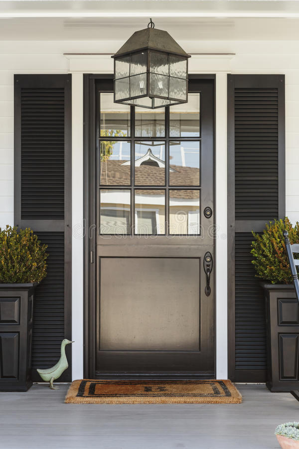 Free Black Front Door To A Family Home With Porch Royalty Free Stock Image - 39176866