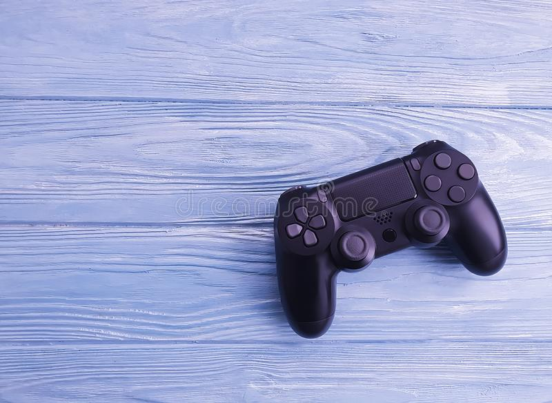 Black game controller on wooden background multimedia royalty free stock photography