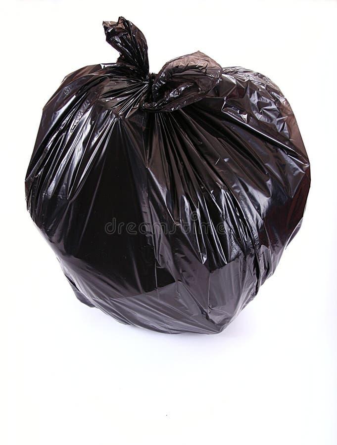 Black garbage bag. Isolated on white stock image