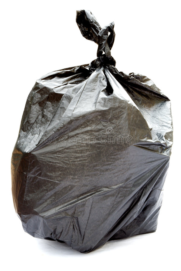 Black garbage bag. Isolated on a white background royalty free stock photos