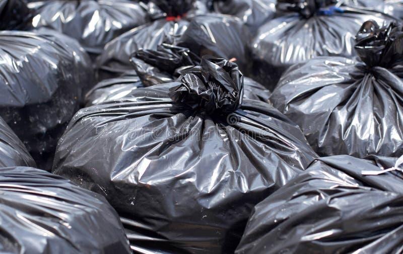 Black garbage bag on the street. Pile of Black garbage bag on the street stock image
