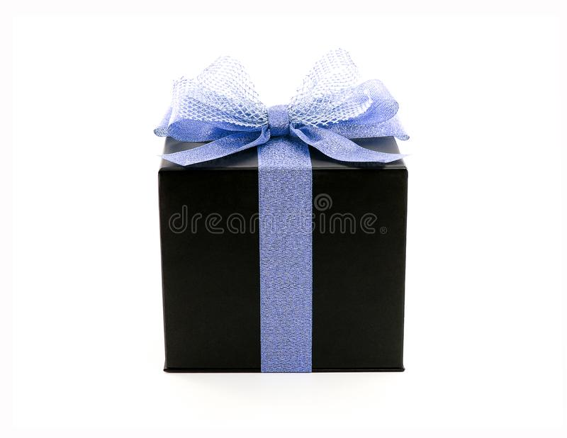 black cube shape cardboard gift box with glittering blue purple color ribbon and net tied bow isolated on white background stock photo