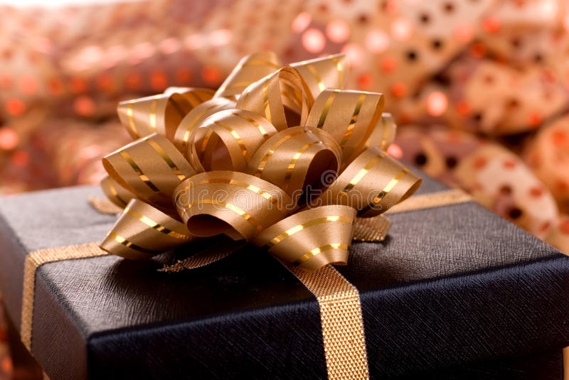 Black gift box with gold ribbon. Black gift box with gold ribbon in macro mode stock image