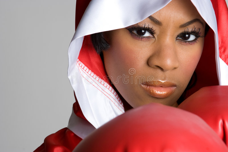 Black Girl Boxing. Angry black sports girl boxing royalty free stock image