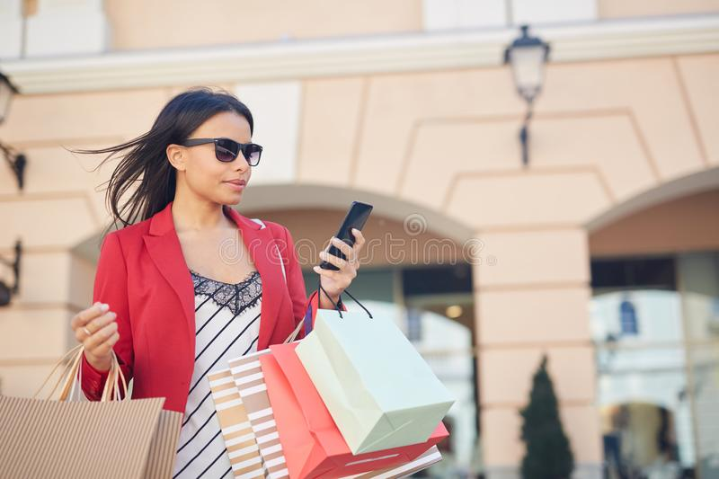 Black girl with many shopping bags royalty free stock photography