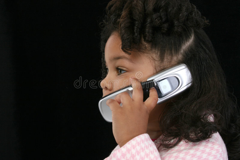 Black girl with mobile stock photography
