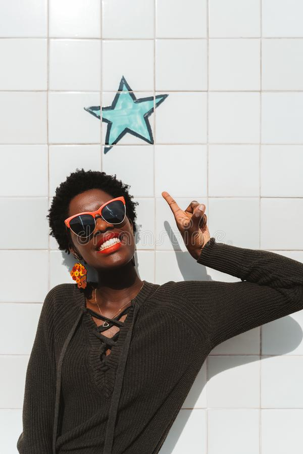 Black girl posting on a painted star royalty free stock photos