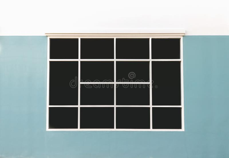 Black glass window. With green walls stock photography
