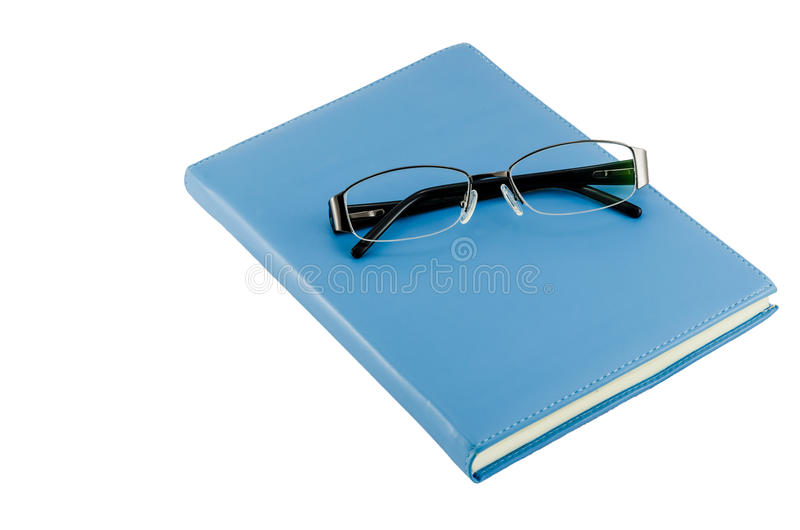 Black glasses on blue diary
