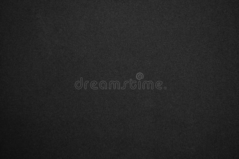 Black glitter background textured, Sandpaper texture abstract background stock images