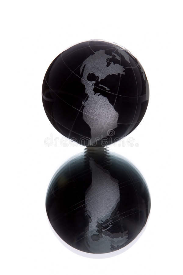 Black globe. With white continent over white background with reflection royalty free stock images