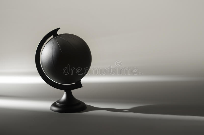 Black globe. Painted black globe earth planet in shadow royalty free stock photo