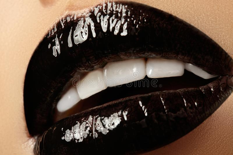 Black glossy lips makeup. Macro beauty shot of face part. Halloween look with black lipstick stock image