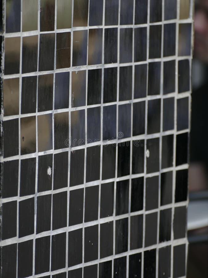 Black glossy mosaic tiles pattern. A black glossy mosaic tiles pattern texture stock photo