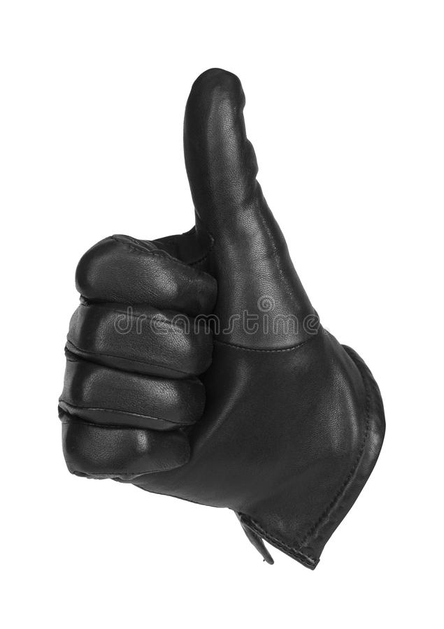 A black glove making the gesture of thumbs up stock image