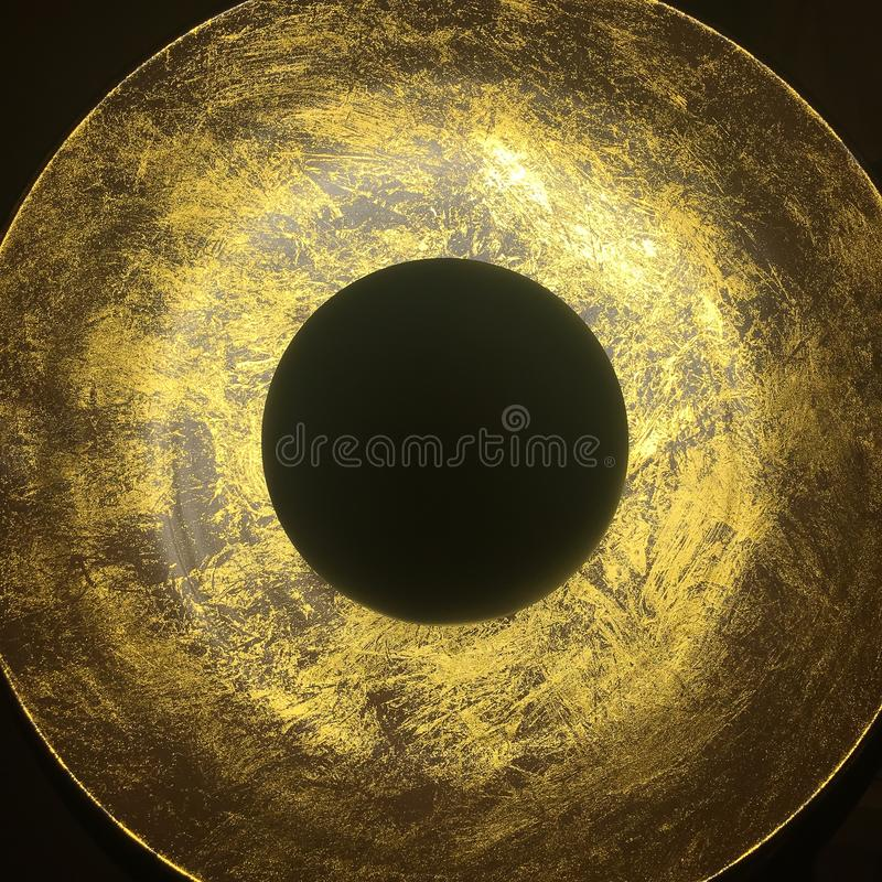 Black and gold circles on dark background.  stock photo