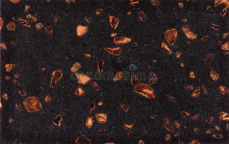 Black and gold granite texture. Polished black granite texture with golden inclusions. Stone surface background stock images