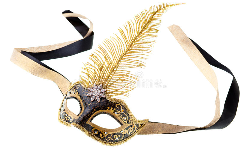 Black and gold mask. Isolated on a white background royalty free stock photos