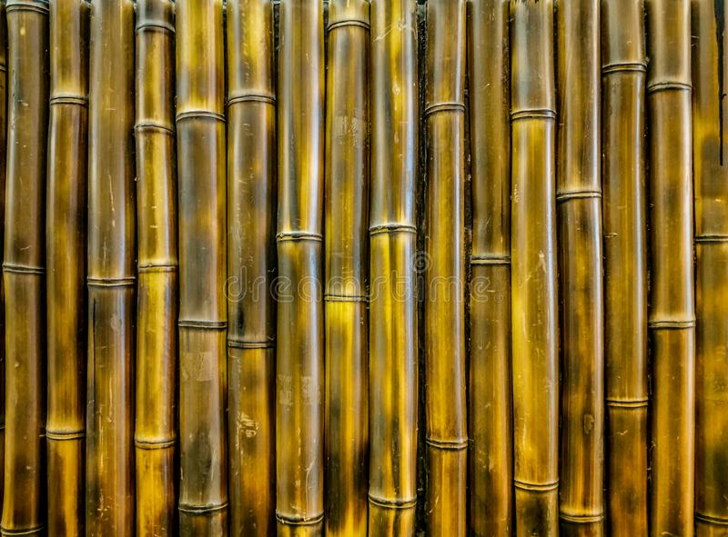 Black and golden bamboo wall, Small bamboo is nailed to form a wall. Brown, abstract, art, background, closeup, color, colour, construction, culture, dark stock images