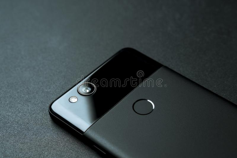 Black Google Pixel 2 Phone Backside. Montreal, Quebec, Canada - March 25, 2018: Backside view of a black Google Pixel 2. The smartphone is laying flat on a black royalty free stock image
