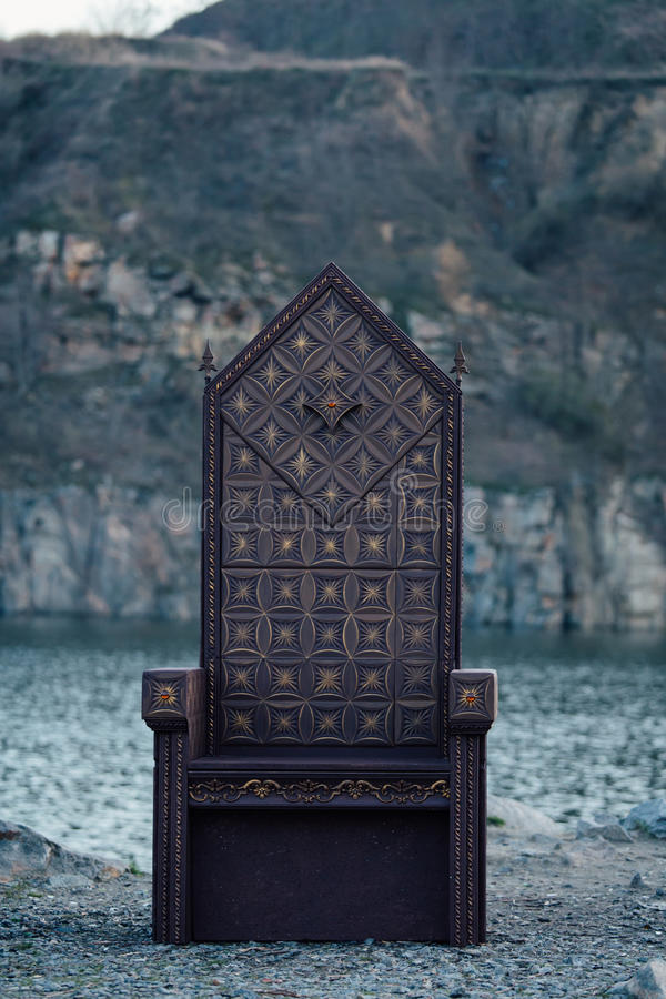 Black gothic throne. Against the dark rocky mountains, vampire, hip toning, creative color, dark-Boho stock photos